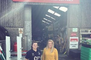 Pictured are City of Derry YFC members Emma Montgomery and Rachel Chambers with one of the donations for the raffle