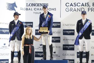 Left to right, Ben Maher (Great Britain), Martin Fuchs (Switzerland) and Michael Duffy (Ireland) stand on the podium following the Longines Global Champions Tour Grand Prix at Estoril in Portugal (Picture: Stefano Grasso)