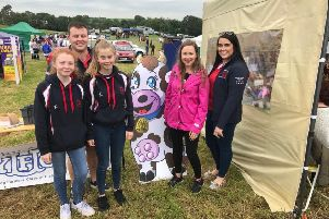 Left to right are club members Amy Macauley, Ellie Heenan, Matthew Murphy (secretary) and Lois Bingham (PRO) pictured with YFCU Moo and YFCU president Zita Blair at the Rathfriland YFC stand at Newry Show