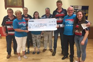 Club members Harry Wallace, Alison Davis, Steven Hogg and Claire Forsythe presenting Epilepsy Action members Glenda Henry, Claire Mulholland, David Archibald and Barry O'Hagan