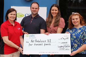 Student Representative Council President Laura Agnew and her deputy Conor McCartney along with SRC member Stephanie Cargill present cheque to Air Ambulance representative.