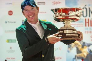 Greg Broderick holds the winners trophy following victory in the Gijon Grand Prixf