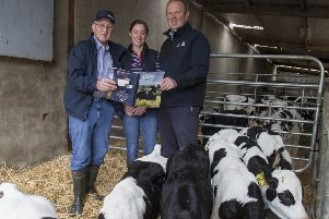 Alan MacCombe, his daughter, Maureen Keys and Richard Walker, Genus ABS are pictured with some of the herd replacements. Photograph - McAuley Multimedia.