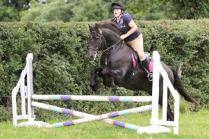 Gillian and horse Gadaffi on their way to winning the 80cm competition.