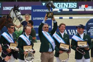 Paul O'Shea, Peter Moloney, Rodrigo Pessoa, Darragh Kenny and Cian O'Connor stand on the podium following Ireland's win in the Longines FEI Nations Cup Final which secured Olympic qualification (Photo: Sonya Hennessy)