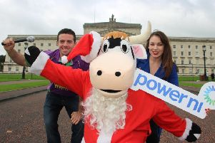 Left to right are, Andrew Patton, YFCU vice president, 'Moo' The YFCU mascot and Amy Bennington, commercial marketing manager, Power NI
