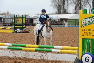 Annabelle Claire riding Toffee from Markethill Primary School, winners of the 50cm Individual