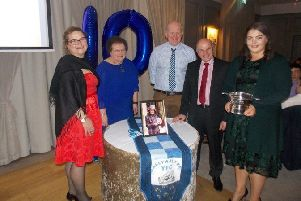 The McAdam family with Geoffrey Patton and Rachel McCracken. Rachel was rewarded the McAdam cup for the most enthusiastic senior at the dinner.