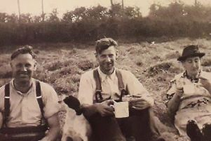 Pictured in the 1950s enjoying tea in the hay field at Lettergreen, Co Fermanagh, are James and Michael Donegan. The are pictured with Elizabeth McAree. Picture courtesy of Bygone Newtown Facebook page/ Paul Mc Loughlin, chairman of the Newtownbutler Community Development Association