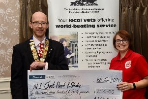 Outgoing President Paul Crawford handing over a cheque for �2330 to the N.I. Chest, Heart and Stroke representative, Laura Thompson.