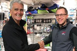 Dave Pegg (left) thanks Andrew Sparrow of MDH Sports & Leisure for the backing that has enabled him to go on the England Over-60s tour to Australia