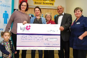 From left, Natasha Goodman and her daughter and Bella, two, present the cheque to breast care nurses Sophie Ferry and Pippa Kilcoyne, consultant onco-plastic Surgeon Salam Musa and breast care matron Annie Jasper