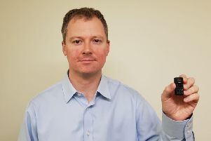 Neil O'Brien MP with one of the tiny phones