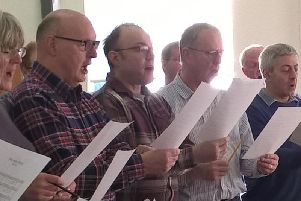 The singers in rehearsal