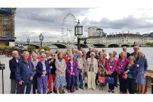 The U3A members by the Thames outside the Houses of Parliament