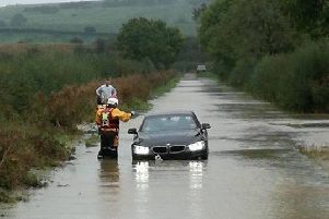 Wellingborough Fire Crew White Watch waded through the floods to rescue two women trapped in in their cars in Green Lane, Weston by Welland,  yesterday October 15