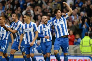 Lewis Dunk (far right) celebrates scoring against Norwich. Picture by Phil Westlake (PW Sporting Photography)