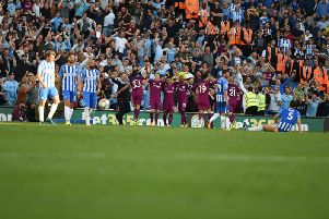 Manchester City celebrate as Brighton & Hove Albion look dejected after the second goal put in by Lewis Dunk. Picture by PW Sporting Pics