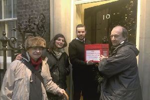 Patrick Glass, Kay Avery and William Bullin deliver residents' demands to 10 Downing Street SUS-171220-111501001