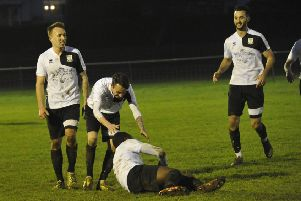 Bexhill United celebrate after Georges Gouet breaks the deadlock against Seaford Town. Pictures by Simon Newstead