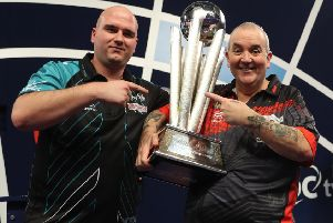 Rob Cross (left) and Phil Taylor with the William Hill World Darts Championship trophy. Picture courtesy Lawrence Lustig/PDC