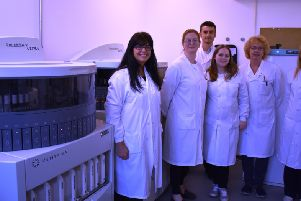 Pathology staff at the Conquest with some of their new pathology equipment SUS-180618-135705001