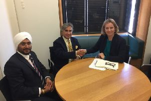 Amber Rudd with  Abid Gulzar, the new owner of Hastings Pier, and Manasdeep Singh. SUS-180619-143923001
