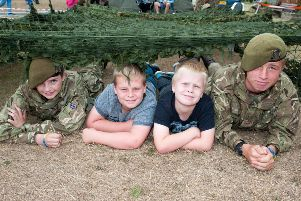Last year's Littlehampton Armed Forces Day. In Photo: The Littlehampton Army Cadets stand (Left to Right) William, age 14, Ryan, age 11, George, age 8, and Josh ,age 16.