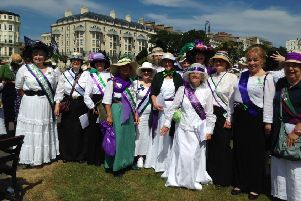 Harmony One choir dressed as suffragettes SUS-180716-091638001