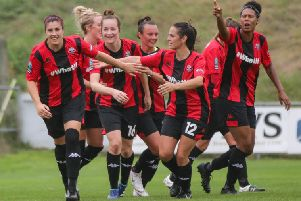 Lewes team-mates congratulate Dani Lane (left) who scored twice in the 5-0 victory over Charlton Athletic