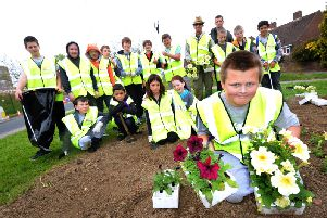 Ore in Bloom, one of the groups to benefit from the latest round of grants, planting and litter picking with pupils from Hastings Academy in 2013