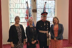 Sarah Marzaioli BEM and HM Lord Lieutenant for East Sussex, Mr Peter J Field  flanked by colleagues Abi Turners and Anitia Smith SUS-181121-150612001