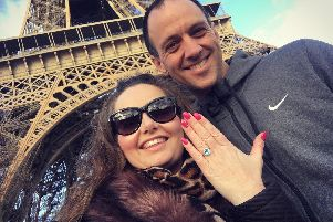Vicki and Gavin celebrate their engagement in front of the Eiffel Tower