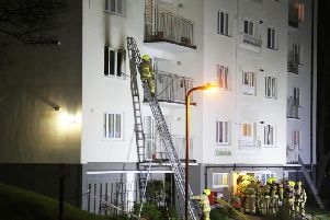 Crews tacking high rise fire in Brighton