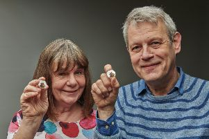 Julia Donaldson and Axel Scheffer with The Royal Mint's Gruffalo coin.