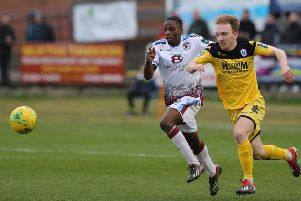 Hastings United wide player Lanre Azeez in a race for the ball against Haywards Heath Town. Picture courtesy Scott White