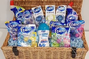A hamper chock-full of Bloo cleaning products
