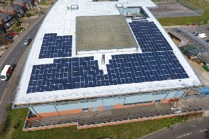 Solar panels on the roof of East Sussex College's Ore campus. SUS-190325-142422001