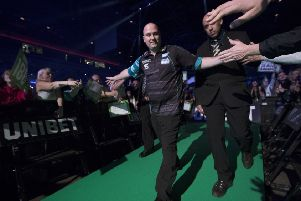 Rob Cross makes his way to the stage before his match against Peter Wright. Picture courtesy Lawrence Lustig/PDC