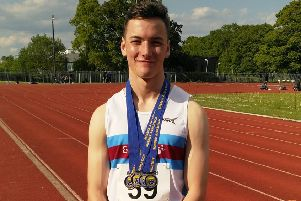 Pyers Lockwood with his medals from the Sussex Track & Field Championships