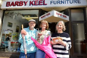 Shop manageress Susan Baxter (centre) with Joan Boylin (left) and Yvonne Ward (right) outside Barby Keel's charity shop in Bexhill. SUS-180613-104227001