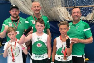 West Hill Boxing Club's William White, Lee Bartley and Taylor Field with club coaches at the Bristol Box Cup