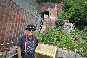 Jasper Barnard pictured in his back garden next to West Hill Lift