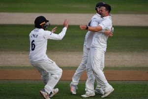 Elliot Hooper of Sussex celebrates the wicket of Dawid Malan of Middlesex during the Specsavers County Championship: Division Two match between Sussex and Middlesex at The 1st Central County Ground on August 19, 2019 in Hove, England. (Photo by Mike Hewitt/Getty Images)