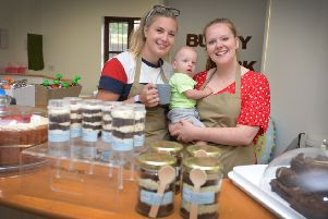 Caf� staff Amber Page and Alice Osborne with 9 month old Jake MacDonald