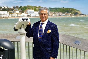 Sheikh Abid Gulzar pictured on Hastings Pier. Photo by Sid Saunders SUS-180619-165701001