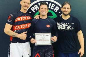 Paul Bridges presented with his certificate by Jake Shannon and Sam Kressin.
