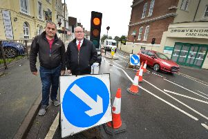 Councillor Phil Scott (right) with 247247 taxi driver Farhad Salihi by roadworks near to Grosvenor Gardens in St Leonards SUS-191016-122743001