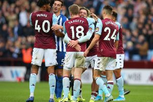 Aston Villa celebrate their late winner against Brighton and Hove Albion at Villa Park