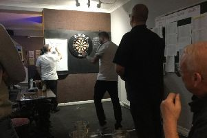 Adrian Gray celebrating his second 180 in the final against Ian Lewington